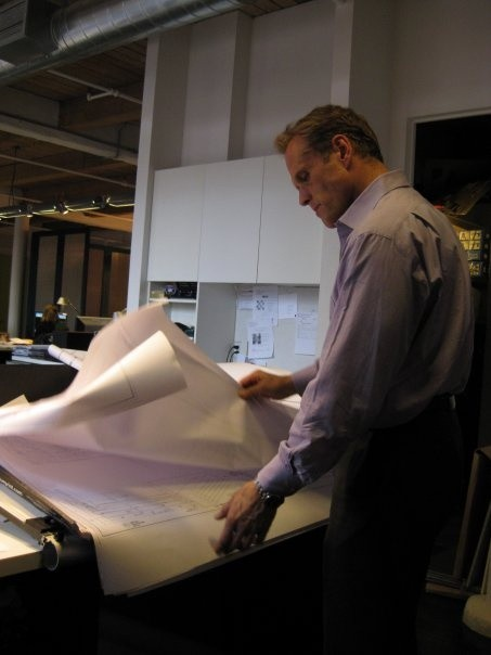 Mark Holmquist Architect NYC looking over some architectural plans for a new building in NYC.